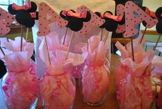 Minnie Mouse Table Centerpieces with child's initial. Paint black styrofoam balls, add a pink ribbon. Pain child's letter. Hotglue onto a wooden craft stick and place into jar. So simple !