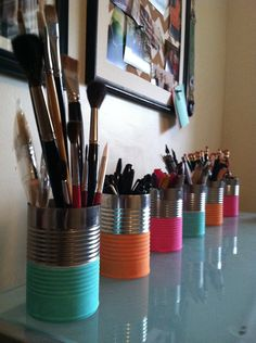Recycling household items, DIY. Painted cans are great for organizing art supplies or office items