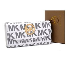 """Michael Kors Wallet Jet Set Continental Vanilla  Products Description * Michael Kors Wallet Continental Monogram Vanilla * MK monogram PVC * Golden hardware. * Flap front with MK logo circle plate. * Logo plate at top center. * Inside, center zip compartment * 4""""H x 8 1/4"""" x 1/2""""D."""