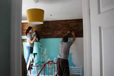 Wooden wall tutorial. They used fence panels from home depot and only spent about $62