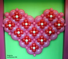 The Quick Link Heart can be made into an even more romantic decor piece with flowery additions. Creation by Luc Bertrand, CBA, with Qualatex balloons. Find a balloon professional near you. #valentines #quicklink #qualatex #balloon #heart