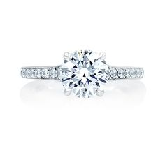 Style ME2024Q Quilted Round Engagement Ring This engagement ring style form the Quilted Collection features graduated diamonds in the shank which create a classic look. #quilted #engagementring #round #diamond