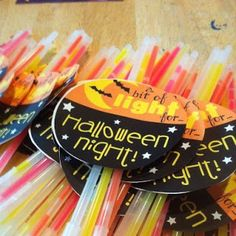 Genius Halloween Treat for the Kiddos- they have 15 packs of them at the dollar store!! Parents can keep an eye on them when it's dark- and what kid doesn't like glow sticks!?!!