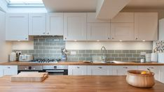 White shaker kitchen with wooden worktops and green metro tiles Kitchen Interior, New Kitchen, Kitchen Design, Kitchen Decor, Wood Worktop Kitchen, Kitchen Black, Kitchen With Green Walls, Kitchen On One Wall, Black And Cream Kitchen