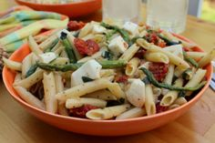 Pasta salad with sauteed asparagus with sun dried tomatoes and basil