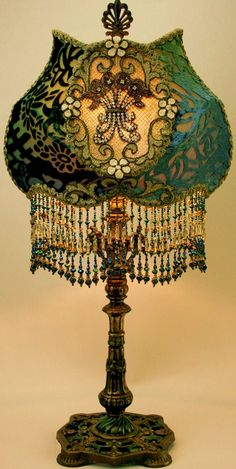 Here is another exquisite Art Nouveau Lamp. The metal used is brass. The teal green glass shade is hand painted & has some gilt work. The base & stem is also painted green & goal. The use of dainty appliques on this shade is so pretty. Victorian Lamps, Victorian Furniture, Antique Lamps, Antique Lighting, Victorian Era, Vintage Furniture, Antique Art, Chandelier Design, Chandelier Lamp