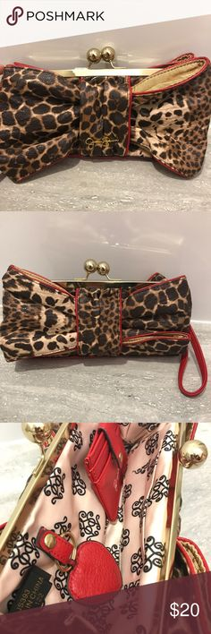 Jessica Simpson Cheetah Jenny Bow Clutch Handbag Authentic Jessica Simpson Leather Cheetah print clutch purse! Like New Without Tags. Red handle and pink silk interior. Fits great in your hand. Slight defect with the wristlet handle (in the last picture) due to rummaging through my purses but never taken outside. Metal clasps to close the clutch with mini wallet inside. Smoke and pet free home. Jessica Simpson Bags Clutches & Wristlets