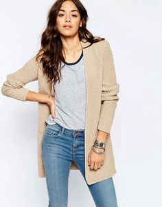 Oatmeal chunky cardigan and light jeans.