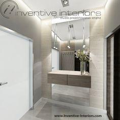 Projekt wiatrołapu Inventive Interiors - duże lustro z wiszącą szafką