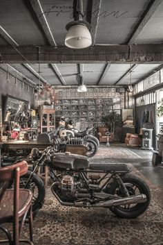 Motorbikes on the living room or like living room on the garage? I found this amazing OFFICINE RIUNITE MILANESI garage by accident way and just walked. Motorcycle Workshop, Motorcycle Shop, Motorcycle Garage, Vintage Industrial, Industrial Style, Industrial Living, Blitz Motorcycles, Vintage Motorcycles, Big Doors