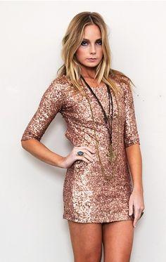 rose gold sequins....love the dress .... not her miz face