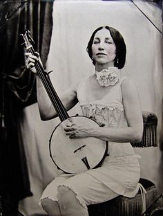 vintage lady either the negative was backwards or she has a lefty banjo - this would be an excellent start for a pin up tat with banjo! WV culture!