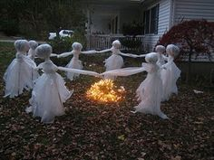 Creepy DIY Halloween Decorations...could make these out of cheese cloth, spray starch, a balloon, wire and a stick.  After popping the balloon, placing on a stick and spraying with starch, they will hold there shape then place them in the ground. ; )