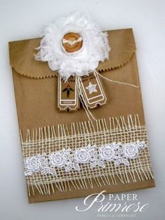 Kraft, natural jute and a fluffy white fabric flower with a wood button center for contrast…