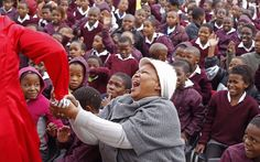A teacher reacts at a school as they celebrate former South African President Nelson Mandela's birthday in Cape Town, Nelson Mandela Birthday, Birthday Celebrations, Former President, Cape Town, Presidents, African, Teacher, Couple Photos, Celebrities