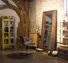 cute vintage rustic salon! I love the mirror, tree on the wall, two-tone hutch, and splashes of yellow!