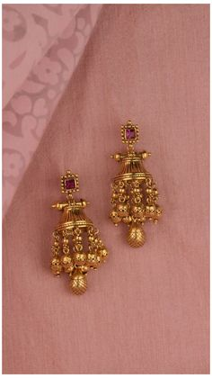 Tiered gold earrings accented with the vibrance of a pink stone #gold #earing #design #new #goldearingdesignnew Tiered gold earrings accented with the vibrance of a pink stone Jewelry Design Earrings, Gold Earrings Designs, Necklace Designs, Beaded Jewelry, Bridal Jewelry, Jewelry Necklaces, Gold Bangles Design, Gold Jewellery Design, Designer Jewelry