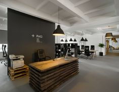 - like a dark gray accent wall behind reception with white logo - B