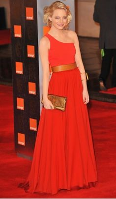 February 13, 2011 | Emma Stone at the Orange British Academy Film Awards in London, England | Top, skirt, and belt by Lanvin; jewelry by Lana.