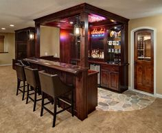 The lighting and moulding in this basement bar, combined with the stone walkway, will make you feel like you're in a cozy neighborhood watering hole!
