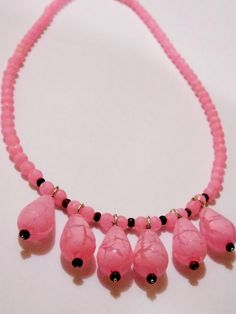 Pink neon beads necklace. Also used small wooden beads. Best for your next party. Just place the order.