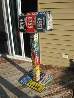 Added License plates to a 4x4 post and a mail box.  Fun project for my backyard... Put my garden tools in it!