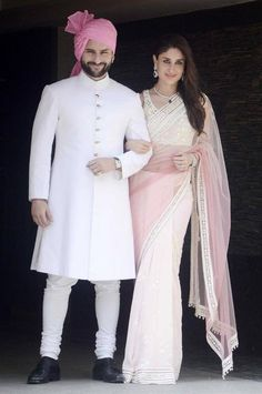 The white sherwani with gold military buttons, simple, elegant and sauve and the pretty pink turban to match with her sari. Saif & Kareena. Shop for your wedding trousseau, with a personal shopper & stylist in India - Bridelan, visit our website www.bridelan.com #Bridelan #Indiangroom