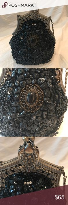Beautifully Beaded Black Evening Smaller Bag Very detailed and embellished gothic or Victorian little bag. Definitely an eye-catcher. It has a main pocket with a kisslock closure.  This is a bit loose. It can be tightened. It is clean. Only tag inside says made in China. No Brand tag.  It is very clean and doesn't appear to show use inside. Some of the beads may be loose from being in storage. It measures about 8 in he's across and 8 inches in height down the middle. Bags Mini Bags
