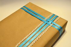 """Ready for your gifts! By Stella and Regina Kraft Paper with Bright Blue Ribbon and Lace Wrapped Apparel Gift Box (9.5"""" X 15"""")"""