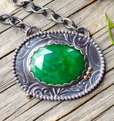 Green beryl necklace in mixed metal. Raw emerald pendant.