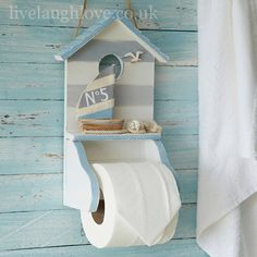 Nautical Toilet Roll Holder: £12.95  http://www.livelaughlove.co.uk/Nautical-Toilet-Roll-Holder.html  In white wash and distressed pale blue this wooden toilet roll holder has seagull, shell, rope and little boat with fabric sail.