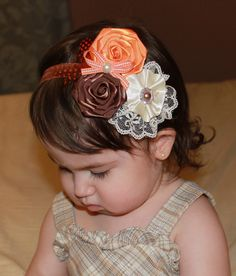 Baby Toddler Girls Boutique Orange, Ivory and Brown Flower roses with lace, feathers and pearl accents on Elastic Headband Photo Prop. $15.99, via Etsy.