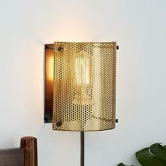 you could add two of these into the dining room for additional light- you would see cords though  Perforated Metal Sconce