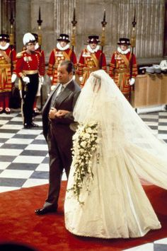 Earl Spencer walks his daughter, Diana, up the aisle.
