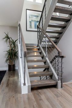 Grey hardwood floors with open staircase & steel railings. like the open stairs Railing Design, Staircase Design, Staircase Ideas, Stair Design, Staircase Remodel, Stair Case Railing Ideas, Modern Stairs Design, Staircase Pictures, Staircase Decoration