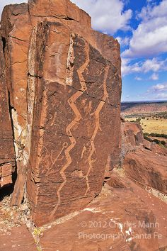 Dramatic Anasazi petroglyphs resembling serpent like figures overlook a valley near the Manzano Mountain ruin of ABO which is part of Salinas National Monument.