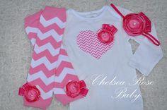 Baby Girl Chevron Heart Bodysuit with a hot pink rose, Matching chevron headband, and Pink Chevron Leg Warmers set