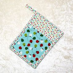 "Quilted Pocket Pot Holder • Christmas Hot Pad • Christmas Ornament • Oven Mitt • Holiday Kitchen Decor • Christmas Decor • Holiday Potholder   Handmade pot holder featuring designer fabric of retro Christmas string lights and a matching dot fabric adds fun to your kitchen. 6.5"" x 9"", with a 2"" hanging loop."