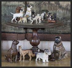 Various bronze and iron dogs on English mahogany salesman's sample table.  Linda Kay McCloy - alittleenglishinteriors.com