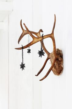 Blackbird Christmas Feeling. I have a faux deer head with antlers (That's high gloss white) as a statement piece in my bedroom and during the holiday season it is a perfect spot to decorate!