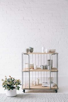 All-white room with indoor planter, grey rug and storage trolley. The modern country look. More decorating ideas like this at www.redonline.co.uk