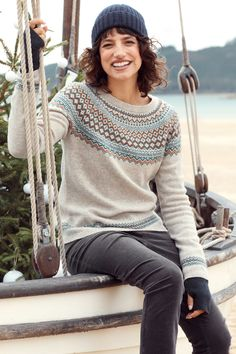 Luxurious jumper with Fair Isle patterns inspired by traditional Scandinavian knitwear. Our Seas Edge Jumper is made from warm and cosy merino wool, with an easy, flattering fit, raglan sleeves and a cosy rolled edge crew neck.