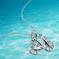 Bicycle Pendant Necklace. Made from 925 Sterling Silver.   Pendant size is approximately 1 x 0.75 inches (2.5 x 1.9 cm).  Chain is 18 inches (46 cm). FREE Shipp