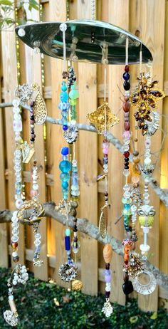 Sun Catcher - Vintage jewelry windchime - garden art.  Here is another idea for that old jewelry and necklaces!  Don't forget to follow my board for other great vintage jewelry ideas!