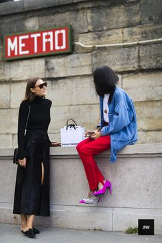 Giorgia Tordini and Gilda Ambrosio wearing Balenciaga during Paris Fashion Week Spring Summer 2017
