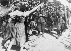 THE GERMAN OCCUPATION OF THE SUDETENLAND, 1938: Ethnic German women give a jubilant reception to German troops invading Czechoslovakia.