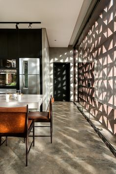 1:1 arquitetura:design ventilates brazilian home using perforated folded walls