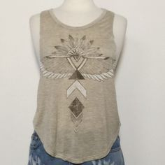 Cute Boho Tribal Arrows/Feathers Muscle Tank Top Super cute muscle tank top with tribal boho print.  Heathered tan in color.  Made in USA! Would be great with some destroyed jeans or shorts and some sandals! Please ask any questions! Thank you! April Spirit Tops Tank Tops
