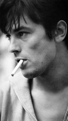 Alain Delon displaying the double whammy of cheekbone and jaw line.