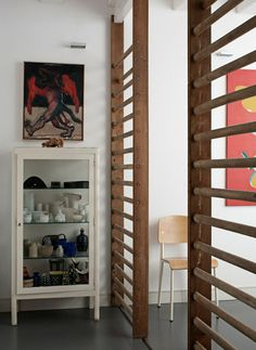 wall bars for room divider. Clever idea to separate parts of studio functionally